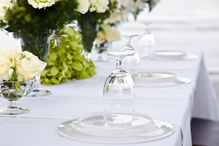 dining table and chairs: Wedding table setting near whe beachfront