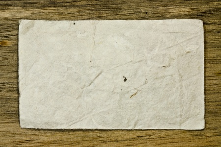 Old paper on wood wall photo
