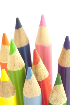 Color pencils over white background photo