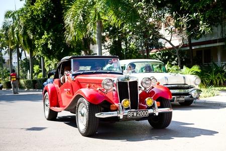 td: HUA HIN - DECEMBER 18: MG TD , 1952 year. Retro Car on Vintage Car Parade 2010 at Sofitel Resort on December 18, 2010 in Hua Hin, Thailand.