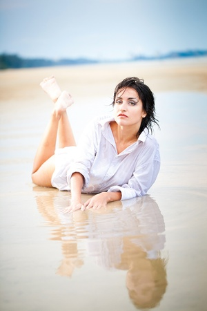 Sexy Woman lying in water photo