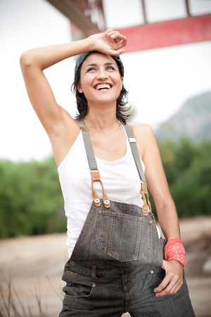Pretty woman dressed in denim overalls photo