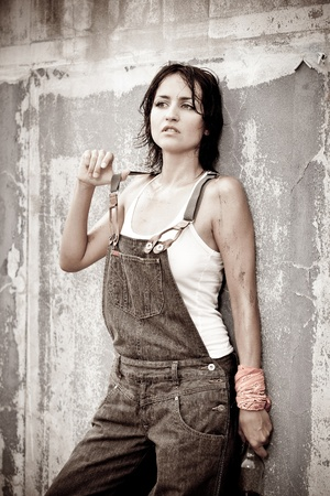 Pretty woman in denim coveralls  photo