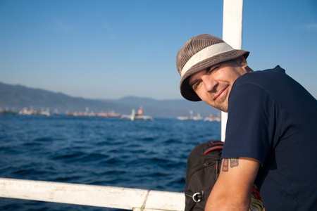 Man sailing on a boat photo