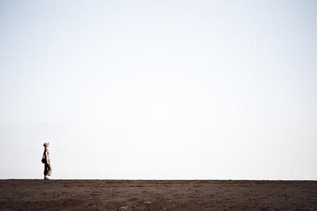 Woman walking on the black sand