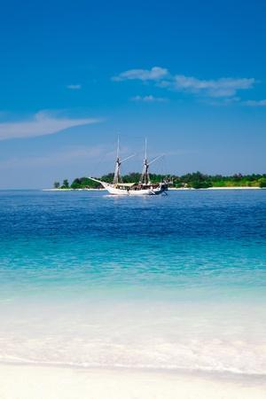 anchored: Sailing ship anchored near the tropical island. Gili, Indonesia