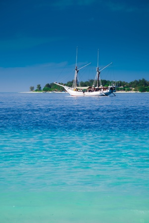 Yacht and paradise tropic island. Gili, Indonesia photo