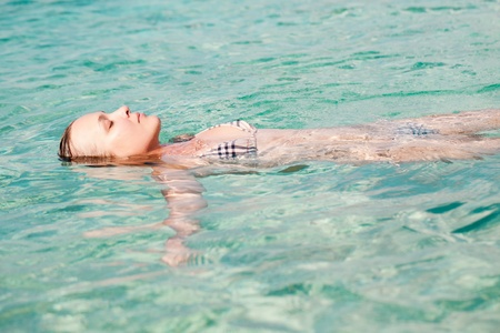 Young adult woman relaxing in the sea Stock Photo - 10851905