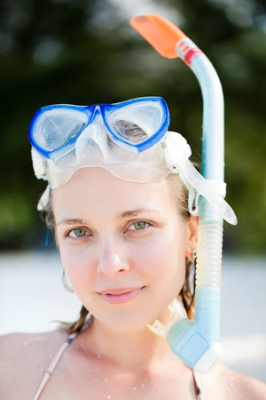 Portrait of snorkeling young adult woman photo