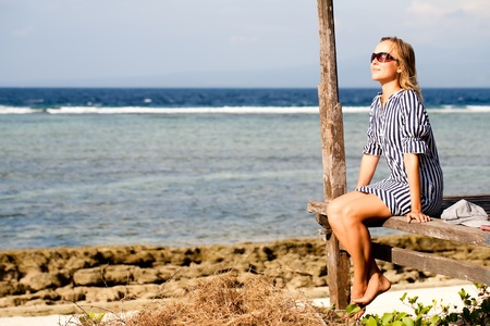 Woman sitting on deck by the sea Stock Photo - 10851906