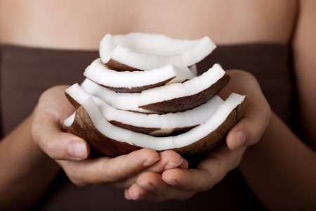 Coconut on hands. SPA collection. photo