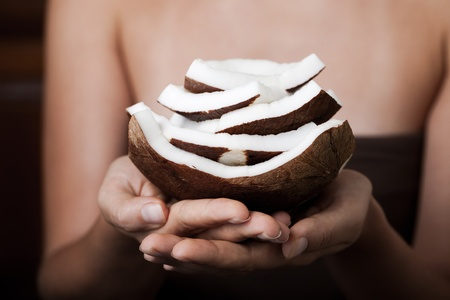 Hand holding coconut. SPA collection. photo
