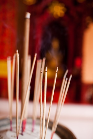 Incense sticks in chinese temple photo