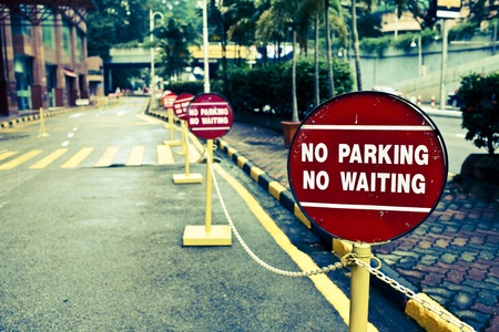 Row of No Parking signs on the street photo