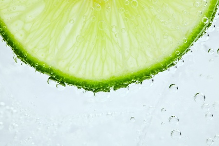 Slice of fresh lime in cocktail Stok Fotoğraf