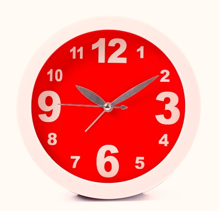 Red clock isolated on white photo