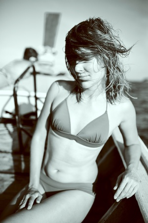 Womans sunbathing on a boat Stock Photo - 11991627