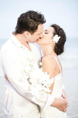 Bride and groom romantic kiss photo