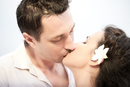Bride and groom kissing outside photo