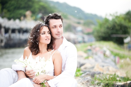 bridal couple: Bride and groom sitting outside
