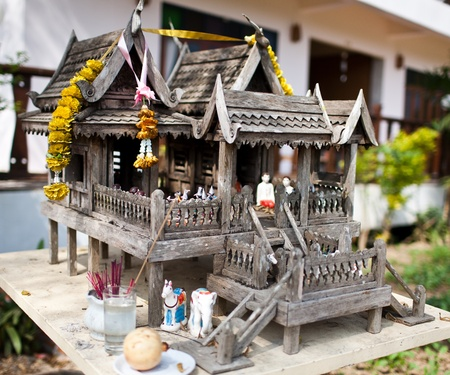 Old style Thailand wooden house of spirits photo