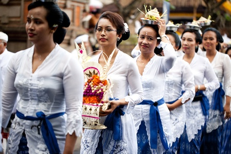 GIANYAR, BALI, INDONESIA- MAY 21: Unidentified villagers bring gifts to the gods at the Balinese Temple during the Odalan Festival on May 21, 2011 in Gianyar, Bali, Indonesia.  Editöryel