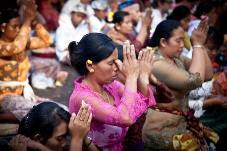 blessing: UBUD, BALI, INDONESIA- JULY 16: Unidentified villagers receive a blessing at the Balinese Temple during the Kuningan Festival  on July 16, 2011 in Ubud, Bali, Indonesia.
