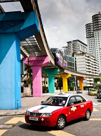 KUALA LUMPUR - NOVEMBER 29: Public transport taxi and monorail train. November 29, 2011 in Kuala Lumpur, Malaysia.