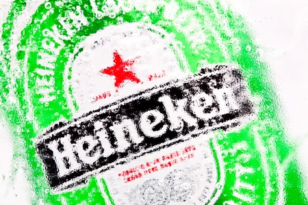 original sparkle: Moscow, Russia, December 3, 2011: A Heineken 0,33l beer can. Heineken beer is brewed by Heineken Brewing Co. Holland.