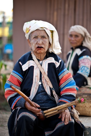 PAI, THAILAND - FEB 3: Unidentified Lahu tribe old woman with lusheng traditional musical instrument, review of daily life of local people, Mae Hong Son province near to Myanmar border on Feb 3, 2012 in Pai, Thailand.
