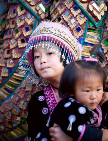 CHIANG MAI, THAILAND - FEBRUARY 4: Traditionally dressed Mhong tribal childrens in procession on Chiang Mai 36th Flower Festival on February 4, 2012 in Chiang Mai, Thailand