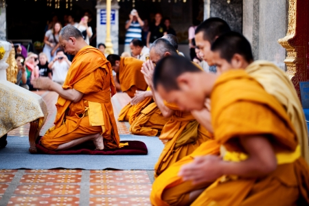 chiangmai: CHIANG MAI, THAILAND - FEBRUARY 4: Buddhist monks praying on evening religion ceremony in Doi Suthep Wat on February 4, 2012 in Chiang Mai, Thailand