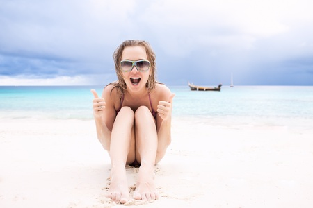 Beautiful young woman having fun on the  tropical beach photo