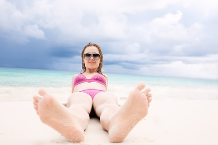 girl soles: Happy beauty girl lying on the beach Stock Photo