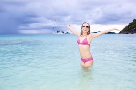 Young girl having fun in tropical water photo