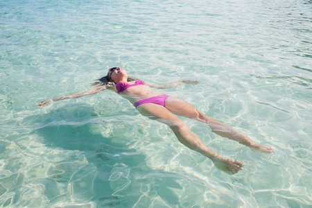 woman floating: Gerl Relaxing in Paradise Tropical Bay Stock Photo