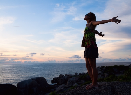 arms outstretched: Success Freedom Woman near the ocean Stock Photo