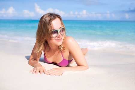 Happy Woman Resting on a Beach photo