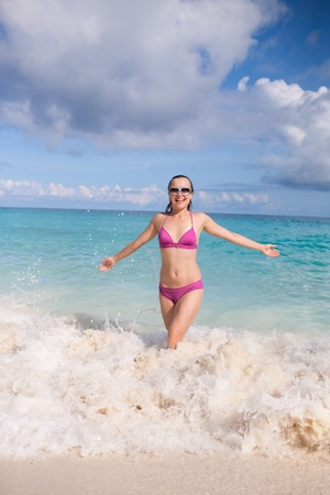 Young Woman Enjoys Tropical Paradise Summer Holiday photo