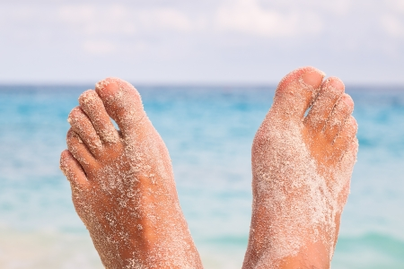 Man Feet by the Sea photo