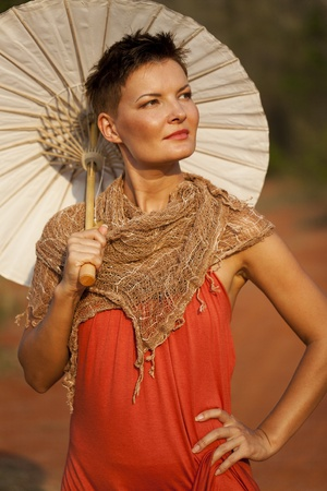 woman umbrella: Portrait of Young Woman with Paper Umbrella Stock Photo