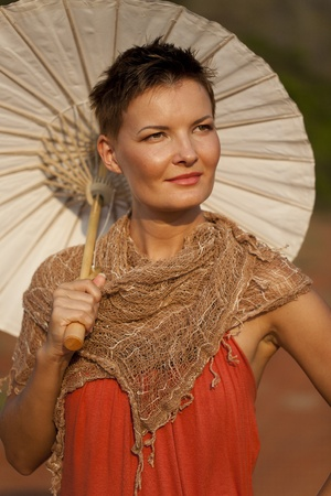 beautiful umbrella: Portrait of Smiling Woman with Umbrella Stock Photo