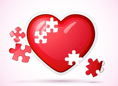Heart made of jigsaw puzzle photo