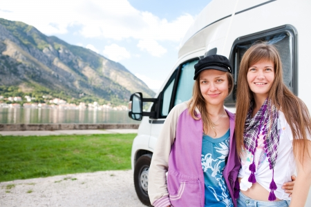 recreational vehicle: Young womans near the recreational vehical Stock Photo