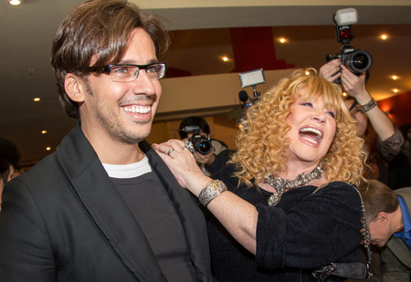sunstroke: MOSCOW - OCTOBER,7 : Singer Alla Pugacheva and M. Galkin. Premiere of the movie Solnechny Udar, October,7 , 2014 at Octyabr Cinema in Moscow, Russia