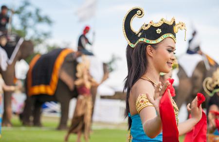 an obeisance: HUA HIN, THAILAND - AUGUST 28: Unidentified thai dancers dancing.  Elephant polo games during the 2013 King s Cup Elephant Polo match on August 28, 2013 at Suriyothai Camp in Hua Hin, Thailand.