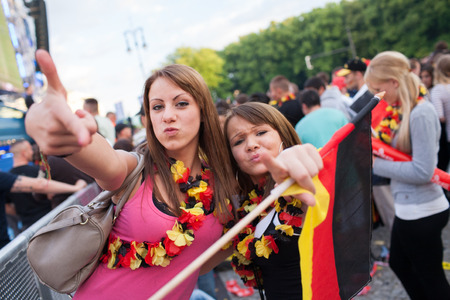 BERLIN - JUNE, 22: Unknown german fans celebrating football game on Euro 2012 near Brandenburger Tor. June 22, 2012 in Berlin, Germany