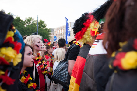 vuvuzela: BERLIN - JUNE, 22: Unknown german fans celebrating football game on Euro 2012 near Brandenburger Tor. June 22, 2012 in Berlin, Germany