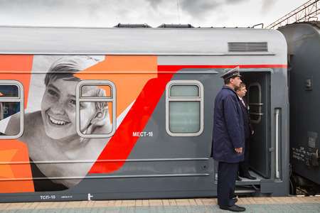 conductors: MOSCOW, RUSSIA, SEPTEMBER, 23: Train Conductors. Train VGIK 95 (Gerasimov Institute of Cinematography) Tour. September, 23, 2014 at Yaroslavsky railway station in Moscow, Russia