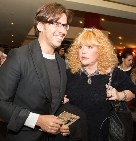 sunstroke: MOSCOW - OCTOBER,7 : Singer Alla Pugacheva and M. Galkin. Premiere of the movie Solnechny Udar, October, 7, 2014 at Octyabr Cinema in Moscow, Russia Editorial